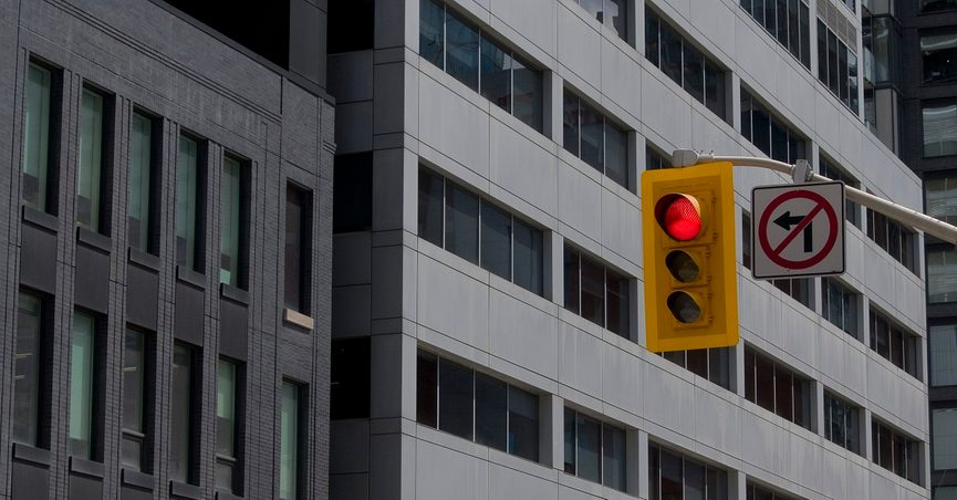 Red Traffic Light over Street Intersection