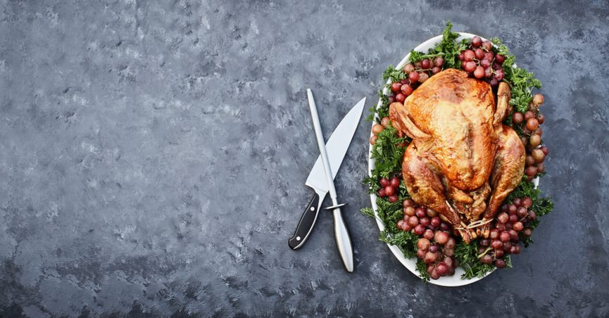 Turkey from overhead next to a carving knife and sharpener