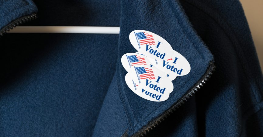 """Lapel with several stickers saying """"I Voted"""""""