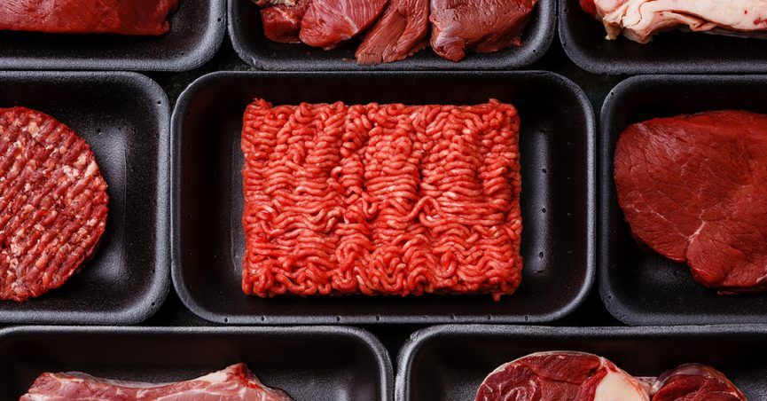 Raw meat displayed in containers.