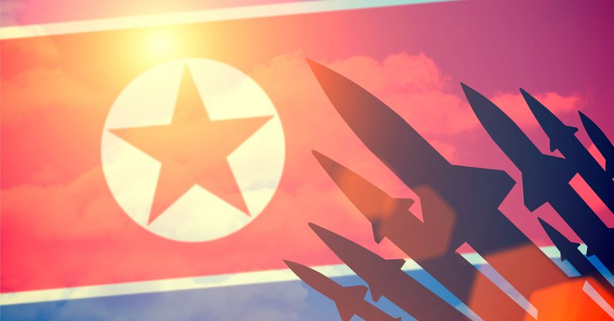 North Korean flag with missile silhouettes.