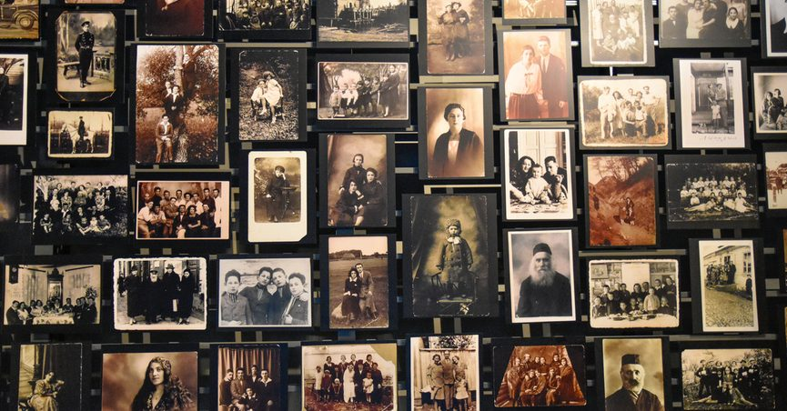 Wall of photographs from Holocaust Museum