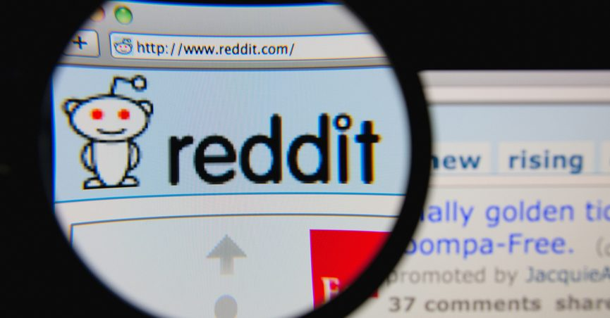 magnifying glass over Reddit homepage