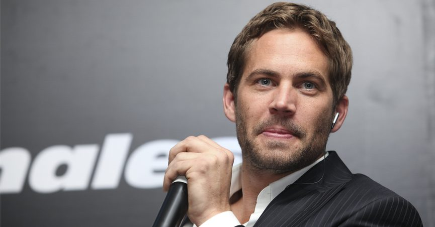 Paul Walker holding a microphone during an interview, 2009