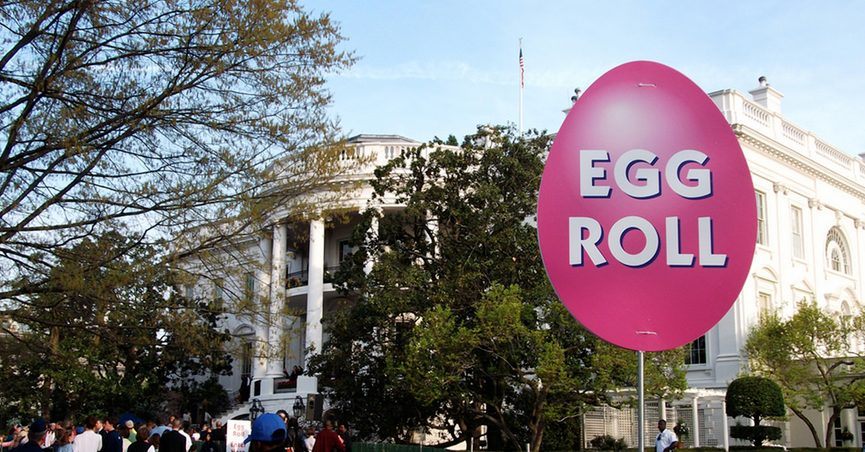 """Sign reading """"Egg Roll"""" in front of White House"""