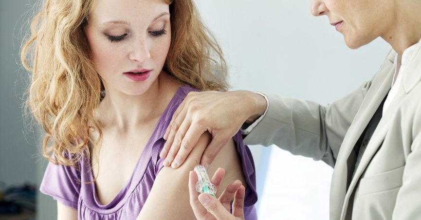 Girl receiving vaccine for cervical cancer