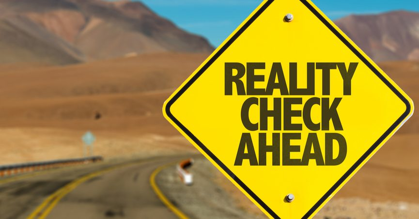 """Sign reading """"Reality Check Ahead"""""""