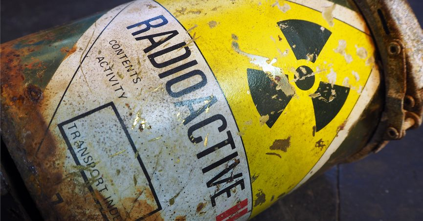 """Worn metal container with """"RADIOACTIVE"""" printed across it"""