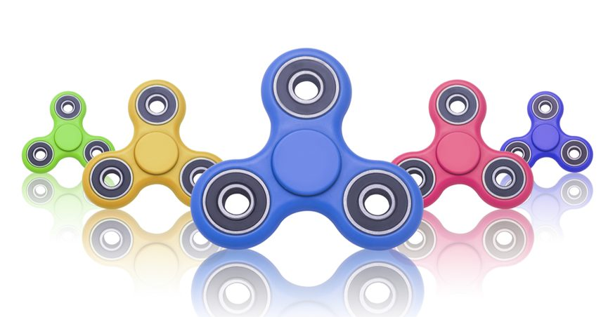 Fidget spinners lined up on a white background