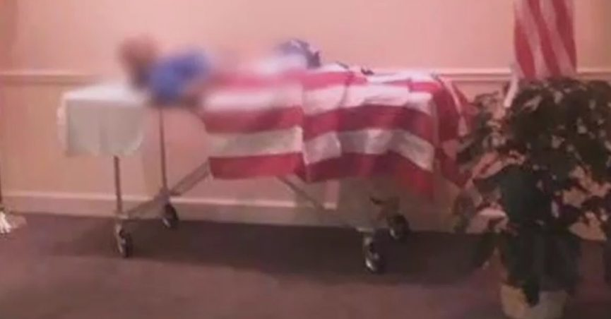 Body of dead veteran draped with American flag