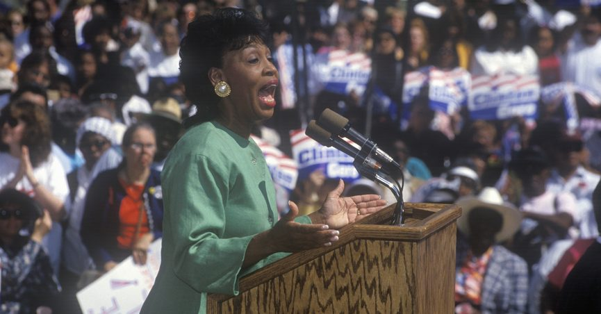 Maxine Waters speaking in front of a crowd
