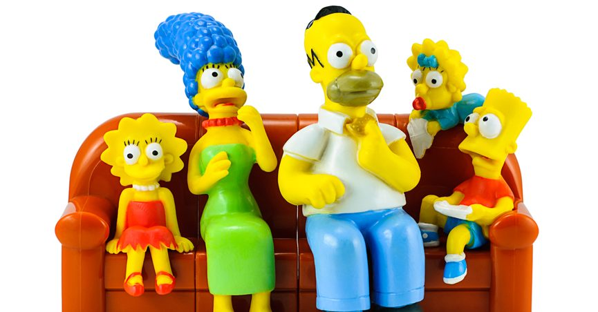 Models of the Simpsons family sitting on their couch
