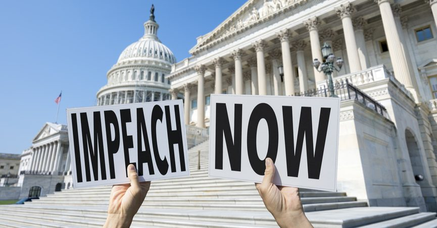 """Hands holding signs reading """"Impeach Now"""" in front of White House"""