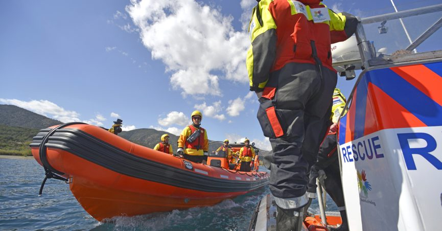 Volunteers rescuing refugees in a boat