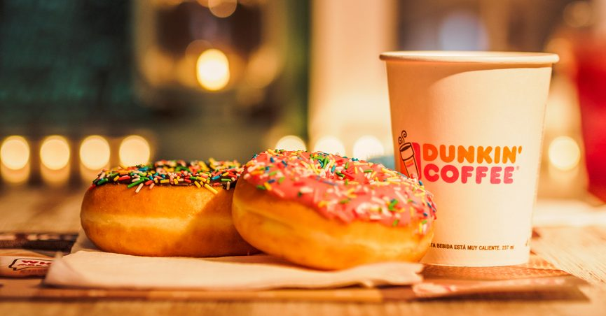 Donuts next to a Dunkin' Donuts cup