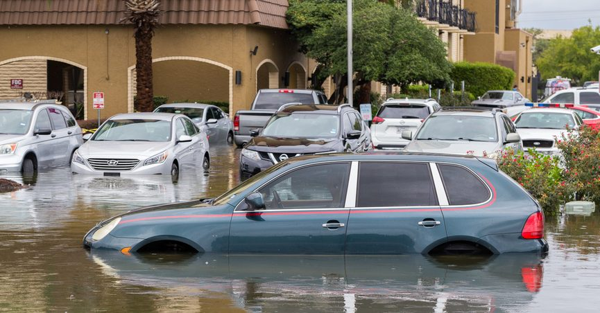 Car halfway submerged in floodwaters