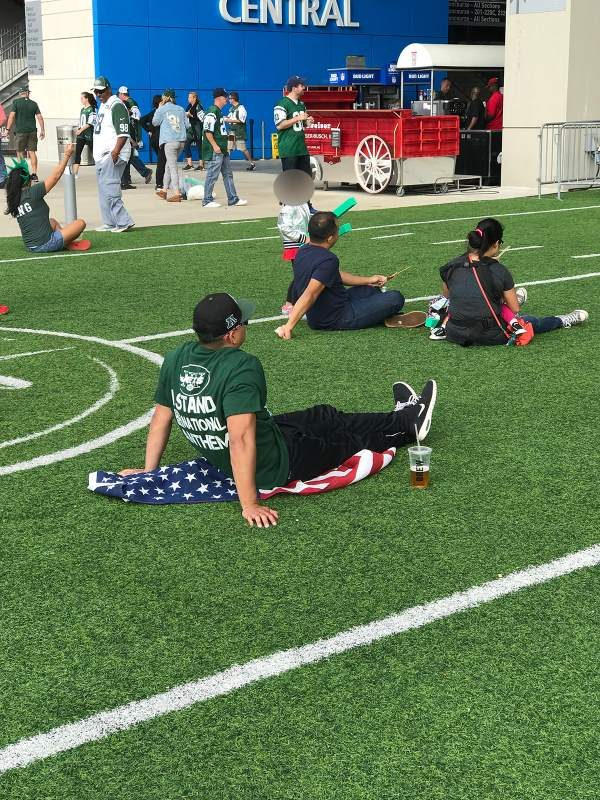 Fact Check Did A Football Fan Sit On An American Flag