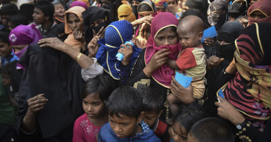 COX' BAZAR, BANGLADESH - MARCH 16, 2017 : Rohingya refugees from Myanmar waiting for food aid in Kutupalong refugee camp near Cox's Bazar, Bangladesh.