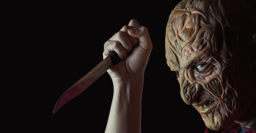 person with horror mask and bloody knife