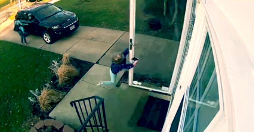 Video still of girl clinging to screen door blowing open from wind