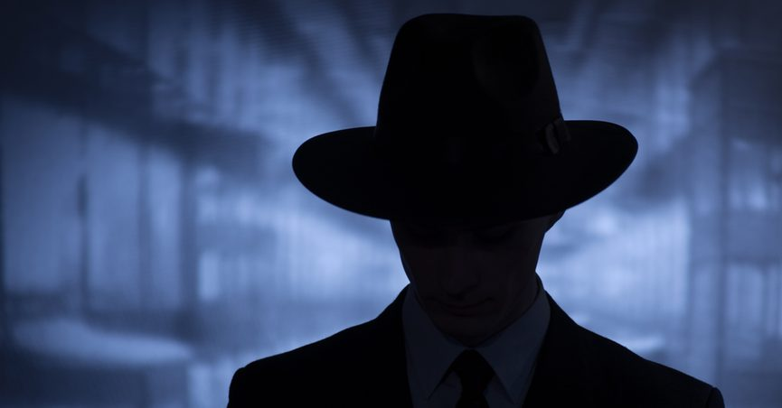 Silhouette of person in hat