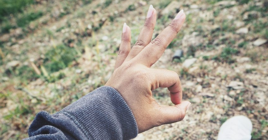 """Hand of person making the """"A-OK"""" or finger circle sign."""