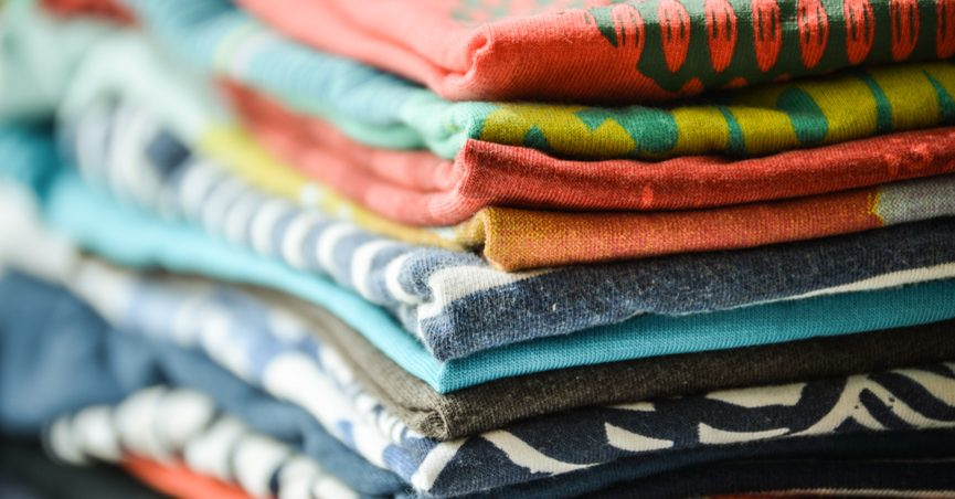 A stack of folded T-shirts.