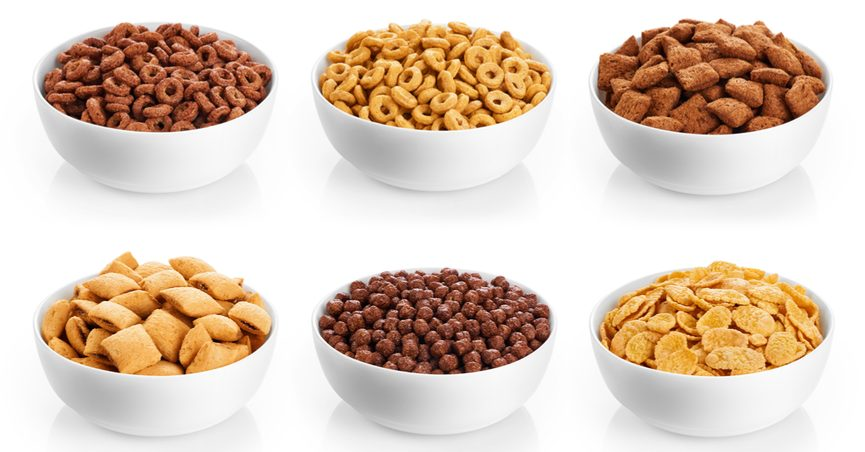 Various bowls of breakfast cereals against a white background.