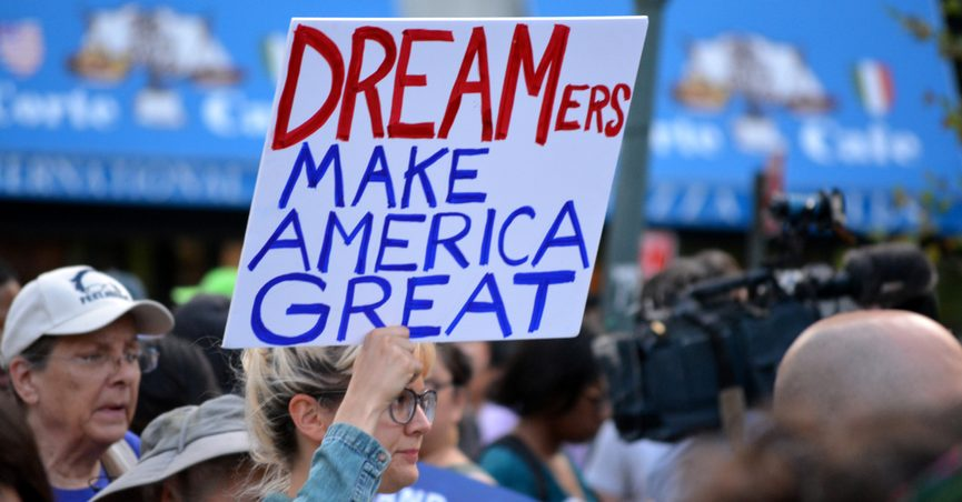 """Protester holding sign reading: """"DREAMers Make America Great"""""""