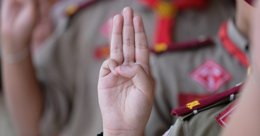 Close-up of hand of Boy Scout swearing an oath.