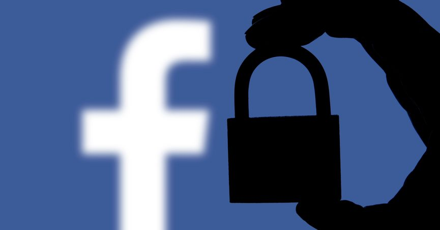 Facebook logo with a silhouette of a hand holding a locked padlock in the foreground.