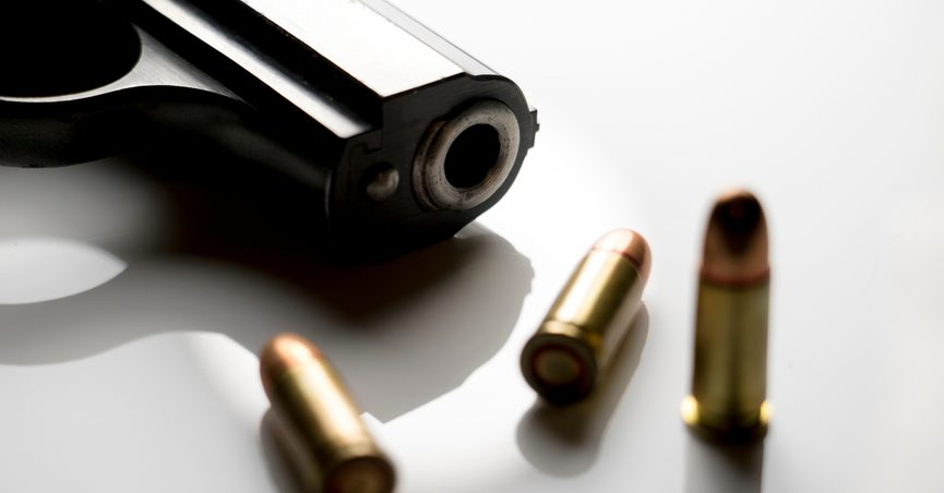 Close-up of a gun muzzle with bullet casings.