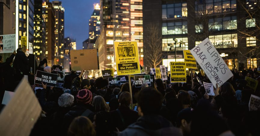 New York, NY / USA - March 28th, 2018: Crowd of Protesters with signs at a demonstration following the death of Stephon Clark.