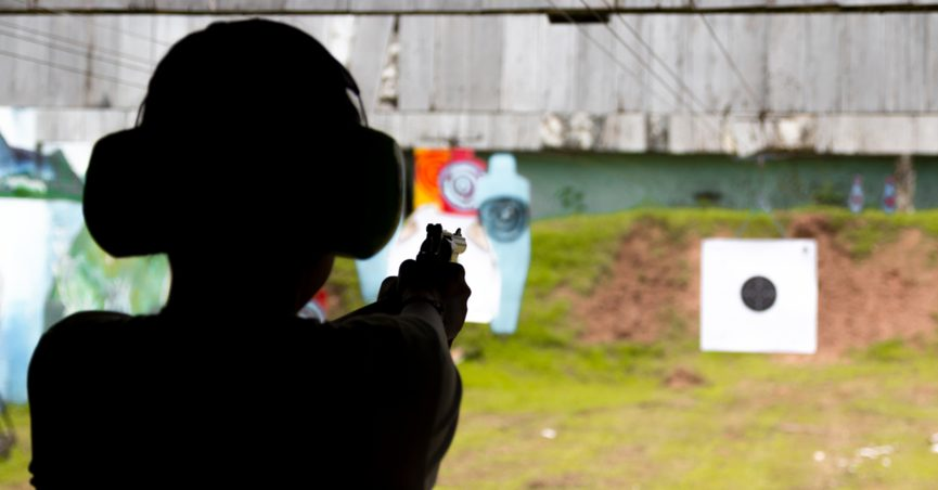 Silhouette of a person at an outdoor shooting range
