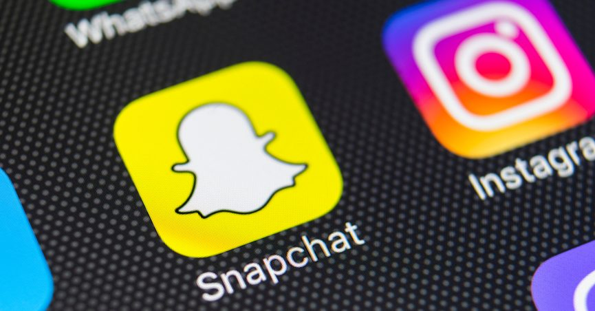Snapchat logo on a mobile phone.