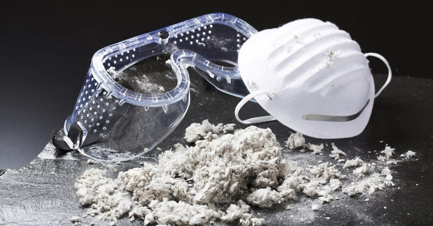 Concept piece showing asbestos alongside safety goggles and a mask.
