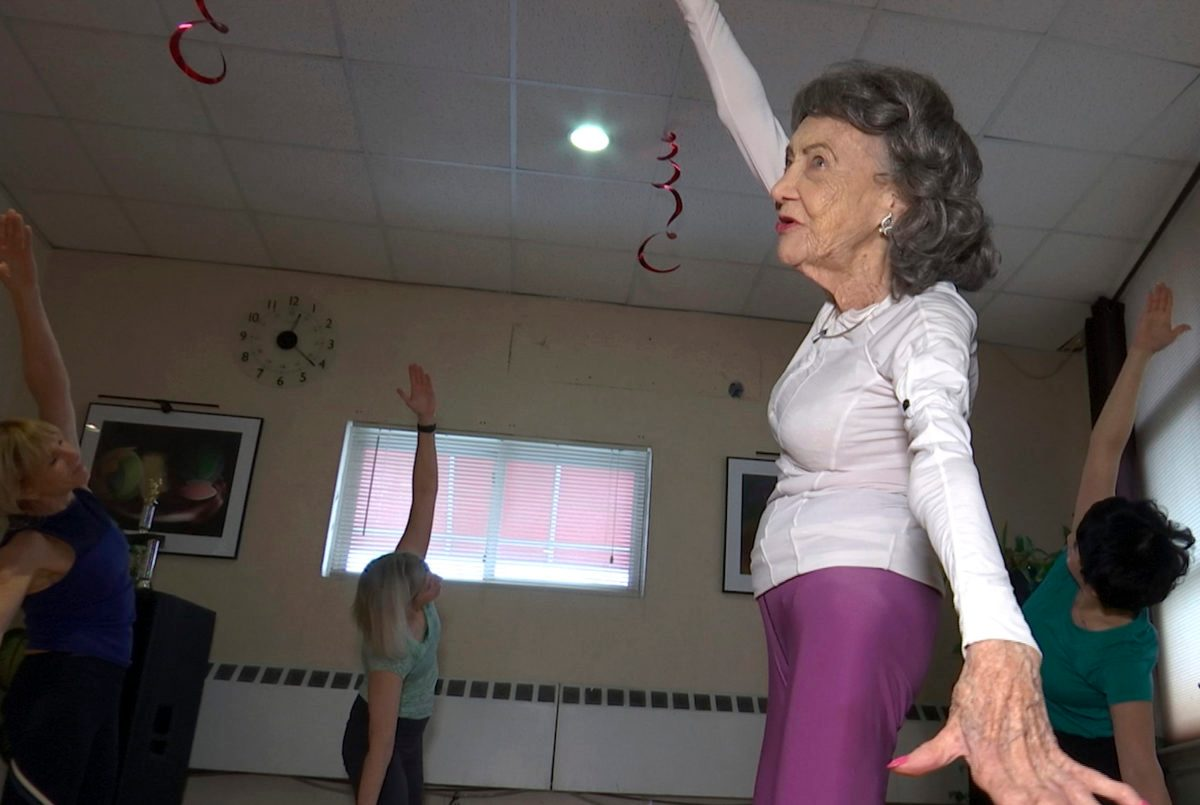 100-Year-Old Yoga Instructor Keeps Moving, Dancing