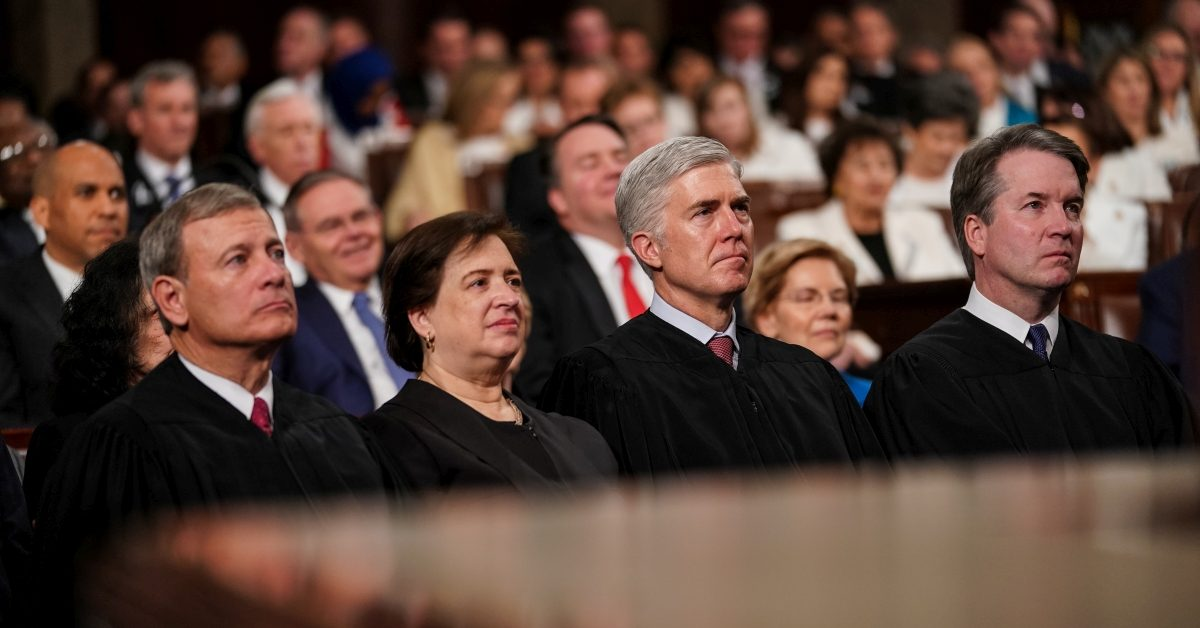 No, a Photo Doesn't Show Justice Roberts with Ghislaine Maxwell