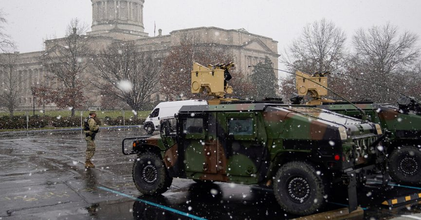 A National Guard Soldier stands outside the Capitol building in Frankfort, Ky., Sunday, Jan 17, 2021. The Capitol, the Capitol complex, and surrounding grounds have been closed. (AP Photo/Bryan Woolston)