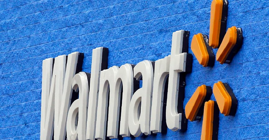 FILE - In this Tuesday, Aug. 4, 2020, file photo, signage is pictured at a Walmart store in Oklahoma City. Walmart announced Wednesday, Jan. 25, 2021, that it plans to build warehouses at its stores where self-driving robots will fetch groceries and have them ready for shoppers to pick up in an hour or less. (AP Photo/Sue Ogrocki, File)