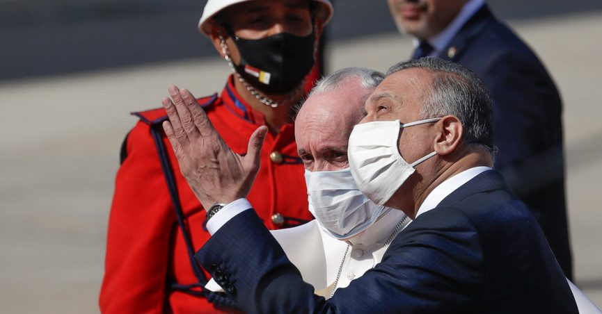 Pope Francis is greeted by Iraqi Prime Minister Mustafa al-Kadhimi as he arrives at Baghdad's international airport, Iraq, Friday, March 5, 2021. Pope Francis heads to Iraq on Friday to urge the country's dwindling number of Christians to stay put and help rebuild the country after years of war and persecution, brushing aside the coronavirus pandemic and security concerns. (AP Photo/Andrew Medichini)
