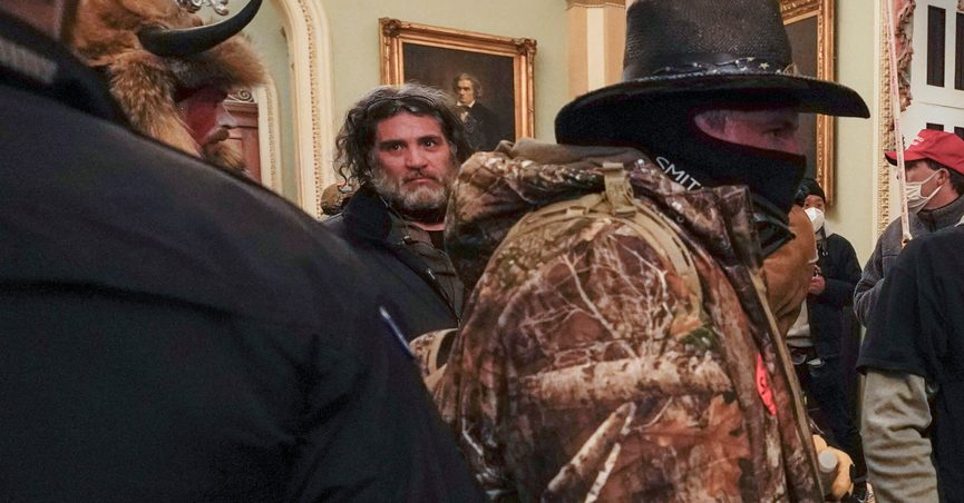 In this Jan. 6, 2021, photo, rioters, including Dominic Pezzola, center with beard, are confronted by U.S. Capitol Police officers outside the Senate Chamber inside the Capitol in Washington. The Proud Boys and Oath Keepers make up a fraction of the more than 300 Trump supporters charged so far in the siege that led to Trump's second impeachment and resulted in the deaths of five people, including a police officer. But several of their leaders, members and associates have become the central targets of the Justice Department's sprawling investigation. (AP Photo/Manuel Balce Ceneta, File)