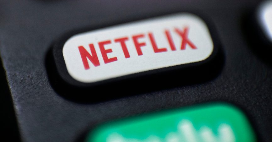 FILE - This Aug. 13, 2020, file photo shows a logo for Netflix on a remote control in Portland, Ore. Netflix is testing a way to crack down on password sharing. The streaming service has been asking some users of the popular streaming site to verify that they live with the holder of the account. (AP Photo/Jenny Kane, File)
