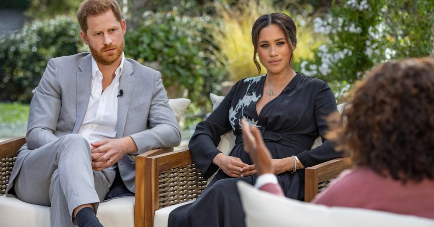 FILE - This image provided by Harpo Productions shows Prince Harry, from left, and Meghan, Duchess of Sussex, in conversation with Oprah Winfrey. Almost as soon as the interview aired, many were quick to deny Meghan's allegations of racism on social media. Many say it was painful to watch Meghan's experiences with racism invalidated by the royal family, members of the media and the public, offering up yet another example of a Black woman's experience being disregarded and denied. (Joe Pugliese/Harpo Productions via AP, File)