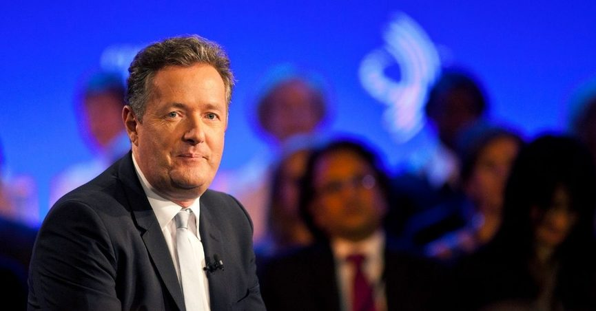 piers morgan, seen here sitting on stage, has been a critic of meghan markle