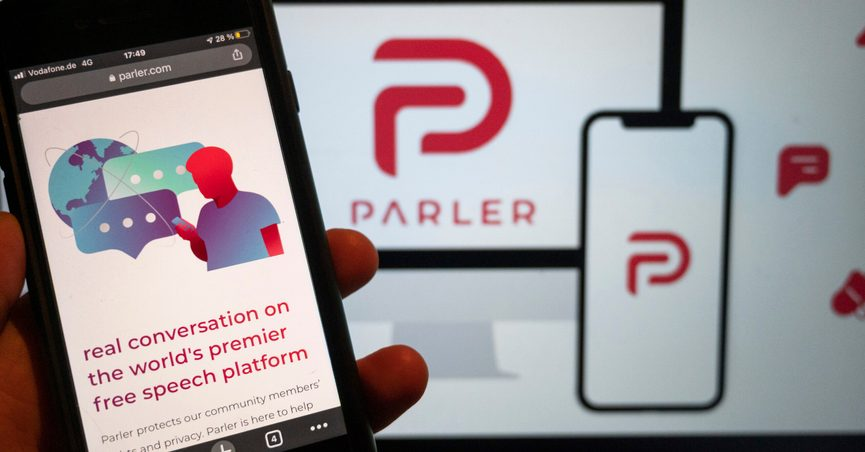 FILE - In this Jan. 10, 2021, file photo, the website of the social media platform Parler is displayed in Berlin. Apple said it has reached an agreement with the right-wing social app Parler that could lead to its reinstatement in the company's app store. Apple kicked out Parler in January over ties to the deadly Jan. 6 siege on the U.S. Capitol. (Christophe Gateau/dpa via AP, File)
