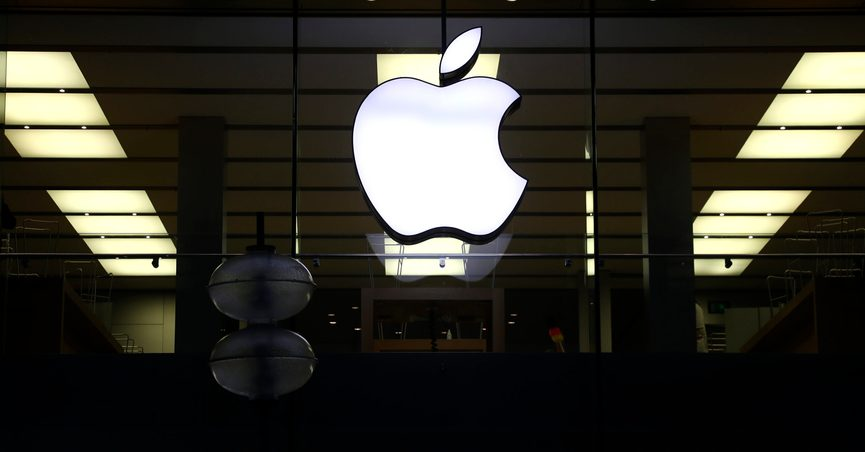 """FILE - This Dec. 16, 2020 file photo shows an illuminated Apple logo at a store in Munich, Germany. Apple is following through on its pledge to crack down Facebook and other snoopy apps that secretly shadow people on their iPhones to help sell more advertising. The new privacy feature, dubbed """"App Tracking Transparency,"""" rolled out Monday, April 26, 2021, as part of an update to the operating system powering the iPhone and iPad. (AP Photo/Matthias Schrader, File)"""