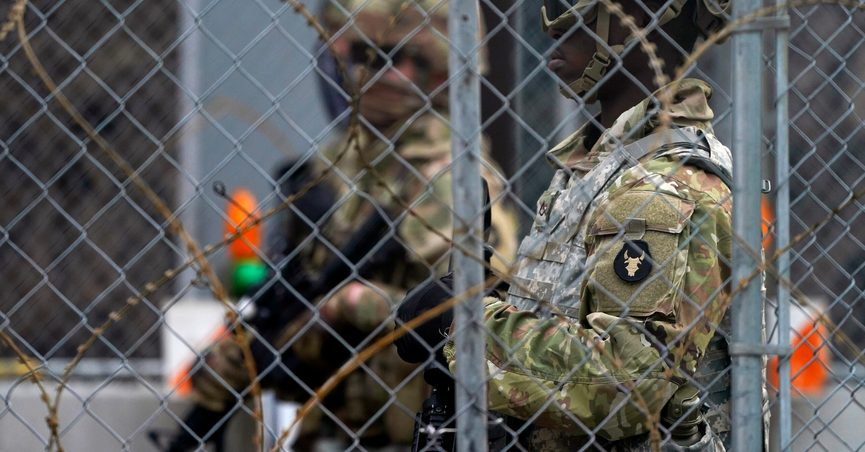 National Guard members are seen through fencing and wire near the Minneapolis Police 3rd Precinct in Minneapolis on Monday, April 19, 2021, after the murder trial against former Minneapolis police Officer Derek Chauvin advanced to jury deliberations. (AP Photo/Julio Cortez)