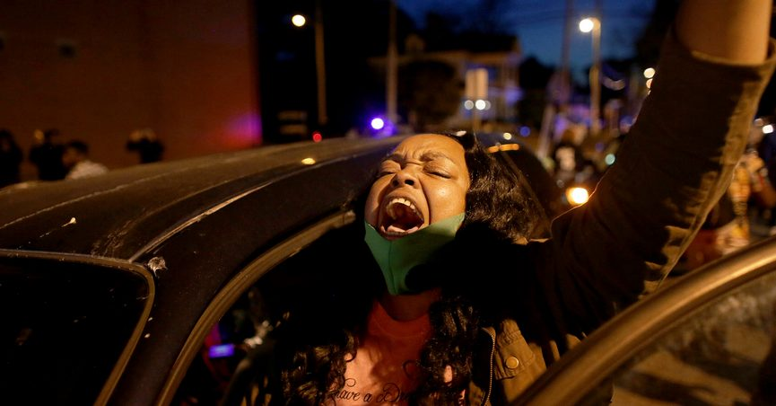 A demonstrator yells from her car as protesters took to the streets in Elizabeth City, N.C., on Monday, April 26, 2021, to protest the killing of Andrew Brown by police and to demand the full body camera footage be released. (Stephen M. Katz/The Virginian-Pilot via AP)