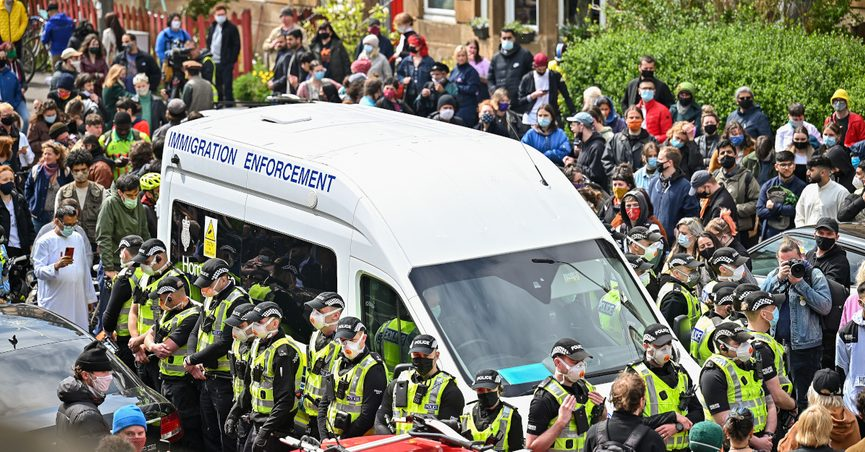 """""""Neighbors in Glasgow surrounded a van that was attempting to arrest a family of immigrants in their neighborhood. A proud day in Scotland!"""""""